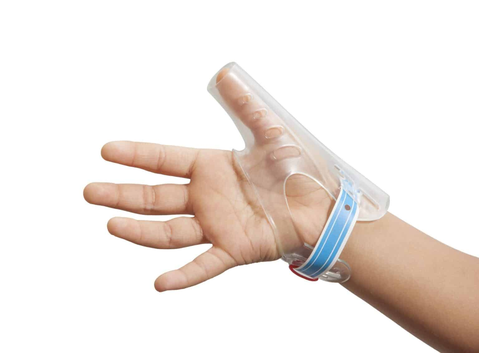 a child's hand, wearing TGuard